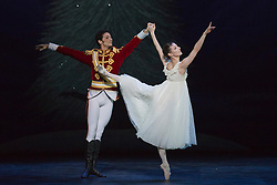 "© Licensed to London News Pictures. 10/12/2014. London, England. Alejandro Virelles as Nephew and Alina Cojocaru as Clara. Dress rehearsal for the ballet ""The Nutcracker"" at the London Coliseum. Set to music by Pyotr Ilyich Tchaikovsky, the traditional Christmas ballet is choreographed by Wayne Eagling based on a concept by Toer von Schayk and Wayne Eagling. The English National Ballet Philharmonic orchestra accompanies dancers from the English National Ballet and Students from the English National Ballet School. Children performers are from the Tring Park School for the Performing Arts. The ballet runs at the London Coliseum from 11 December 2014 to 4 January 2015.  With Alina Cojocaru as Clara, Max Westwell as Nutcracker, Alejandro Virellles as Nephew, James Streeter as Mouse King and Fabian Reimair as Drosselmeyer. Photo credit: Bettina Strenske/LNP"