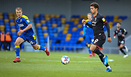 Lincoln City Midfielder Brennan Johnson (20) is chased back by Jaakko Oksanen of AFC Wimbledon  during the EFL Sky Bet League 1 match between AFC Wimbledon and Lincoln City at Plough Lane, London, United Kingdom on 2 January 2021.