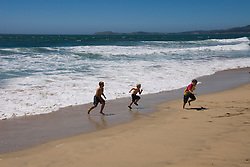 People enjoying the beach at Half Moon Bay Beach,.San Mateo Coast of California, south of San Francisco.  Photo copyright Lee Foster, 510-549-2202, lee@fostertravel.com, www.fostertravel.com. Photo 445-31170