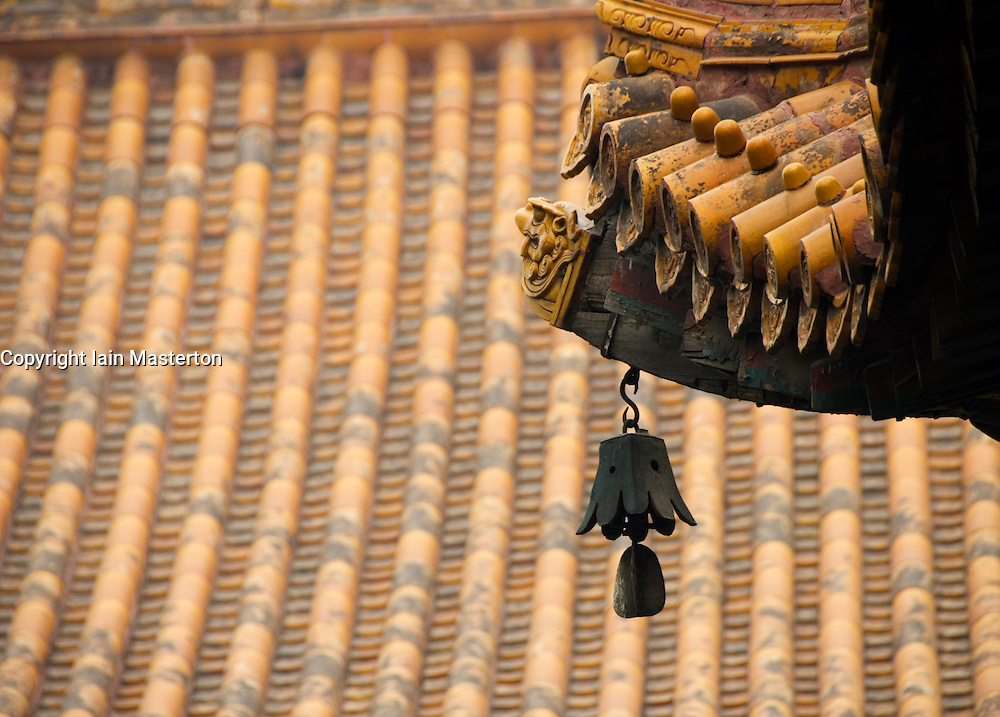 Detail of bell and roof of temple building at famous Yonghegong Lama Temple in Beijing