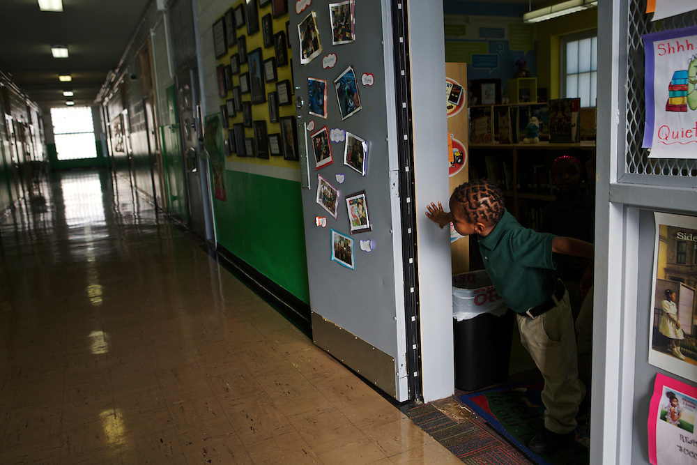 Nathan McNeill, 4, looks down the hall from the new library that was renovated through the Target School Library Makeover Grant at Adelaide Davis Elementary School on Nov. 26, 2012 in Washington, D.C. Last week DCPS Chancellor Kaya Henderson proposed closing 20 under-enrolled schools in the District. Davis Elementary is one of 20 schools in the DCPS system included in the school closure proposal. There are currently 178 students enrolled in Davis Elementary and the second floor of the school is only used for music classes and the library...CREDIT: Lexey Swall for The Wall Street Journal.DCSCHOOLS