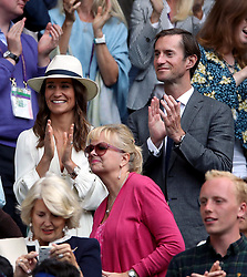 Pippa Middleton and her husband James Matthews applaud Roger Federer after his win on day eleven of the Wimbledon Championships at The All England Lawn Tennis and Croquet Club, Wimbledon.