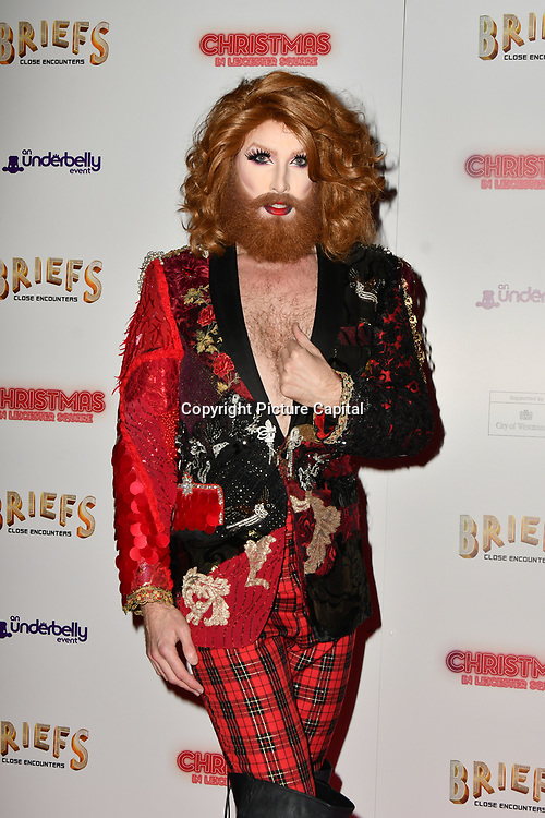 Gingzilla attends Briefs: Close Encounters - press night an All-male 'Boylesque' group show off their circus skills, drag acts and raucous comedy routines at The Spiegeltent Leicester Square on 14 November 2018, London, UK.