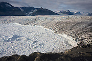 Top view of the surrounding peaks and the calving face of the Columbia Glacier, near Valdez, Alaska.
