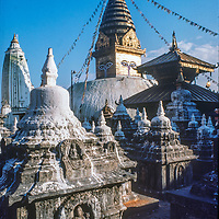 Tibetan Buddhist chortens rise in front of Swayambhu'nath stupa in Kathmandu, Nepal, 1986.
