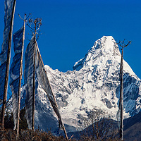 Prayer flags flutter in front of Mt. Ama Dablam in the Khumbu region of Nepal 1986.