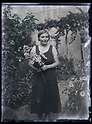 young adult woman holding flowers France 1933