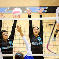 111413  Adron Gardner/Independent<br /> <br /> Navajo Prep Eagles Keona Leano (13), left, and Tanisha Garcia (11) attempt a block on a Cuba Ram during the state volleyball tournament at Cleveland High School in Rio Rancho Thursday.