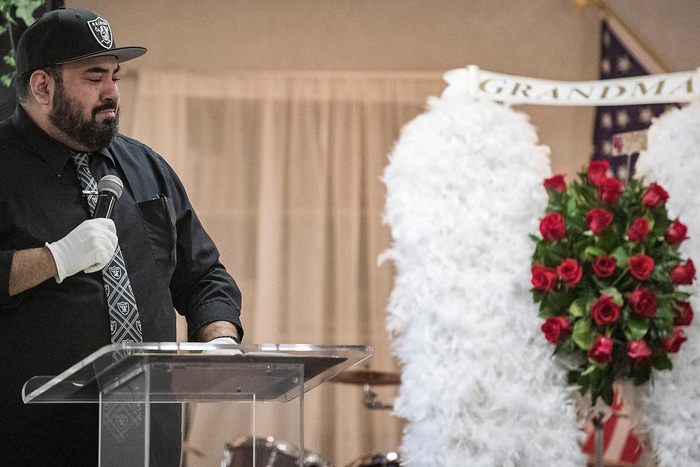 Aaron Rivera becomes emotional while speaking at his grandmother Carmelita Martinez' funeral at Pastor El Buen church in San Jose, Calif. on Feb. 3, 2021.