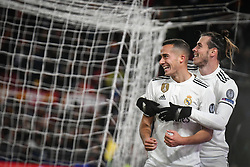 November 27, 2018 - Rome, Italy - Real Madrid's Spanish midfielder Lucas Vazquez (L) celebrates with Real Madrid's Welsh forward Gareth Bale after scoring 0-2  during the Champions league football match between AS Roma  and Real Madrid at Olimpico stadium in Rome, Italy, on November 27, 2018. (Credit Image: © Federica Roselli/NurPhoto via ZUMA Press)