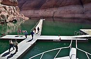 Visitors to Rainbow Bridge National Monument arrive by boat , walk across a floating dock and then hike 1/2 mile to the 290' high natural arch, Wednesday, March 12, 2003.  Tourists to the most popular spot on Lake Powell used to boat within sight of the monument.