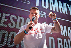 © Licensed to London News Pictures. 14/05/2019. London, UK. Political activist Stephen Yaxley-Lennon - also known as Tommy Robinson -  arrives at the Old Bailey. Judges are expected to hear an application by the Attorney General for a new case against Yaxley-Lennon, after judges last year overturned a finding against him for contempt of court, after he was accused of filming people in a criminal trial in Leeds and publishing the footage on social media.  Photo credit : Tom Nicholson/LNP