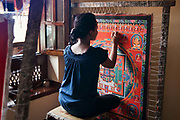 Traditional Nepalese mandala painting in a gallery off the Bhaktapur Durbar Square. A painting can take up to 3 months to finish and often depicts religious symbols , gods and iconography, either Buddhist or Hindu.
