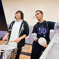 022213       Brian Leddy<br /> Miyamura High School students Nicole Atencio and Skyler Reeder play along with the band during a program at Miyamura High School Friday.