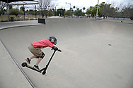 Camden Monnett, 7, rides his scooter at the Orlando Skate Park, which is located in the area known as the Milk District in Orlando, Fla., Saturday, March 25, 2017. (Phelan M. Ebenhack via AP)
