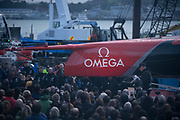 """Sparkling wine is smashed on  """"Te Aihe"""", Emirates Team New Zealand's first AC75 at the christening. Viaduct Harbour, Auckland, New Zealand."""
