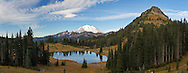 A cold October morning at Tipsoo Lake in Mount Rainier National Park - Yakima Peak is to the right, the Cowlitz Chineys, Barrier Peak and Governors Ridge in center..