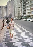 Female tourist standing by the beach at Copacabana, Rio de Janeiro, Brazil 1962