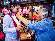 06 MAY 2017 - ST. PAUL, MN: SHAYLEE WATTERSON, 10 years old, and her grandmother, LYDIA CONITO, get Shaylee ready to dance at the 6th Annual Powwow for Hope at Ft. Snelling in St. Paul. Shaylee has had three uncles battle cancer, one died from lymphoma she said he contracted from being around Agent Orange during the war in Vietnam. She said she wears red, white and blue in his honor. The powwow was a fundraiser to support cancer education and supportive services for American Indian communities. Proceeds benefited the American Indian Cancer Foundation's work to eliminate cancer burdens on American Indian families. Cancer is the leading cause of death in Native American communities, exceeding coronary disease and diabetes.       PHOTO BY JACK KURTZ