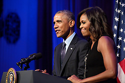 President Barack Obama, with First Lady Michelle Obama, delivers remarks during a reception for foreign heads of delegation to the United Nations General Assembly, at the Waldorf Astoria Hotel in New York, N.Y., Sept. 23, 2014. (Official White House Photo by Pete Souza)<br /> <br /> This official White House photograph is being made available only for publication by news organizations and/or for personal use printing by the subject(s) of the photograph. The photograph may not be manipulated in any way and may not be used in commercial or political materials, advertisements, emails, products, promotions that in any way suggests approval or endorsement of the President, the First Family, or the White House.