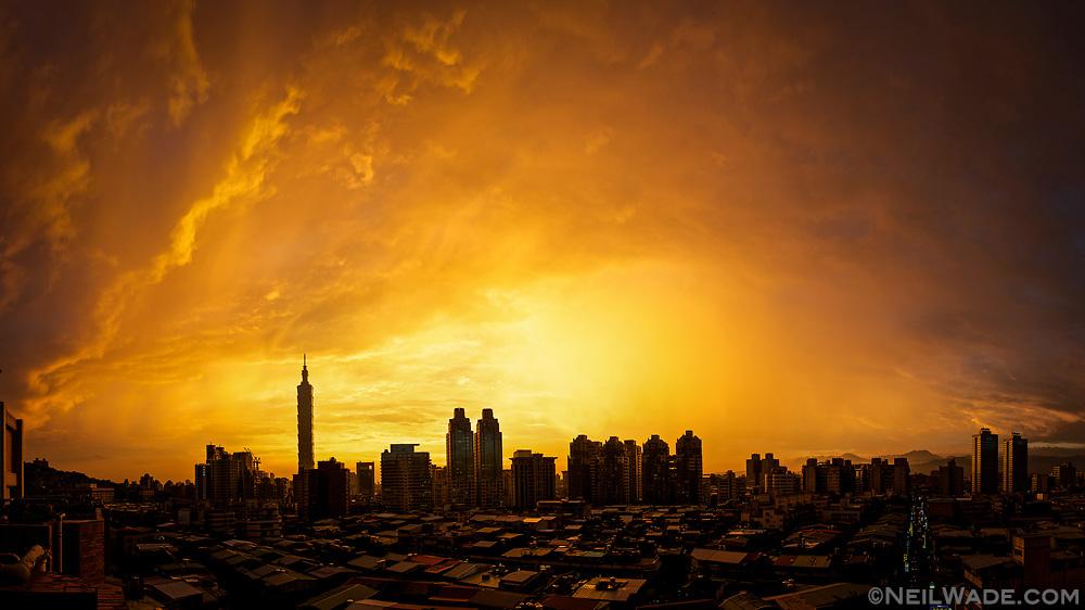 A bright orange sunset over Taipei City, Taiwan.