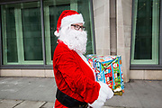 Santa delivering books for prisoners to the Ministry of Justice HQ, central London. Part of the Howard Leagues books for prisoners campaign.