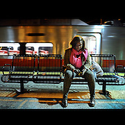 Nekita Waller waits alone on a Tuesday evening for a train to New York City to sing.