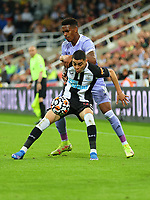 NEWCASTLE UPON TYNE, ENGLAND - SEPTEMBER 17: Miguel Almiron of Newcastle United keeps possession from Junior Firpo of Leeds United during the Premier League match between Newcastle United and Leeds United at St. James Park on September 17, 2021 in Newcastle upon Tyne, England. (Photo by MB Media)