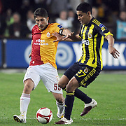 Galatasaray's Sabri SARIOGLU (L) and Fenerbahce's Andre Clarindo Dos SANTOS (R) during their Turkish superleague soccer derby match Galatasaray between Fenerbahce at the AliSamiYen Stadium at Mecidiyekoy in Istanbul Turkey on Sunday, 28 March 2010. Photo by TURKPIX