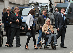 © Licensed to London News Pictures. 11/11/2015. Bristol, UK.  DARREN GALSWORTHY the father of murder victim Rebecca Watts, wheels his wife ANJIE GALSWORTHY, the mother of Nathan Matthews who is accused of Becky Watts' murder, into Bristol Crown court on the day the jury retires to consider their verdict in the Rebecca Watts' murder trial, accompanied by Becky's aunt SARAH BROOM (white jacket) and Becky's uncle SAM GALSWORTHY at right. Photo credit : Simon Chapman/LNP