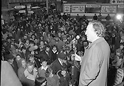 Image of Fianna Fáil leader Charles Haughey touring West Cork during his 1982 election campaign...04/02/1982.02/04/82.4th February 1982..Darkening faces:..Charles Haughey looks over the crowd he addresses as darkness falls.
