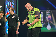 Michael van Gerwen celebrates during the match against Jonny Clayton during the PDC Premier League Darts Night 11 at Marshall Arena, Milton Keynes, United Kingdom on 6 May 2021.