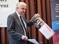 © Licensed to London News Pictures . 16/02/2017. Stoke-on-Trent, UK. PATRICK O'FLYNN holds up the UKIP manifesto as he speaks . Hustings in Stoke-on-Trent Central by-election at the Quality Hotel in Stoke , for local businesses with Lib Dem candidate Dr Zulfiqar Ali, Conservative candidate Jack Brereton,  Labour candidate Gareth Snell and, in place of UKIP candidate Paul Nuttall who didn't turn up , Patrick O'Flynn . Photo credit: Joel Goodman/LNP