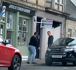 Barber giving haircuts despite lockdown, 14 May 2020<br /> <br /> Pictured: The Antalya Turkish Barber in Mid Calder, Livingston has been open for business against Scottish Government lockdown rules. The owner has advertised he is open and can be seen in the street touting for business. Two young customers accepted his offer and one can be seen getting a haircut.<br /> <br /> <br /> Alex Todd | Edinburgh Elite Media