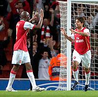 Photo: Ed Godden/Sportsbeat Images.<br /> Arsenal v Sevilla. UEFA Champions League Group H. 19/09/2007. Arsenal's Eduardo (R), celebrates scoring to make it 3-0.