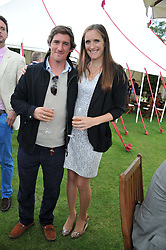 BOBBY DUNDAS and NINA VESTEY at the Cartier Queen's Cup Polo Final, Guards Polo Club, Windsor Great Park, Berkshire, on 17th June 2012.