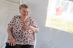 A woman laughs as a daughter visits her mother in a bubble at Fondation Shadet Vercoustre nursing home on May 27, 2020 in Bourbourg near Gravelines, France, where a double entry bubble has been installed to allow visits without risk of contamination, as part of a prophylactic measure against the spread of the Covid-19 disease caused by the novel coronavirus. Relatives and residents each enter the tent through a different entrance to find themselves in the same room, separated by a transparent plastic canvas. These bubbles were originally designed for tourism by the company. Photo by Julie Sebadelha/ABACAPRESS.COM