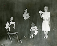 1946 (L to R) Joyce MacKenzie, Narda Stokes, Barbara Fuller & Barbara Bettinger rehearse a play at the Hollywood Studio Club.