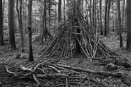 BELGIUM, Brussels. 20/08/2020: Precarious archtecture built by children in the forest.