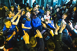 © Licensed to London News Pictures. 09/05/2021. Bolton, UK. The team including GETHIN JONES , HARRY BROCKBANK and RICARDO SANTOS celebrate outside the club's hotel . Bolton Wonderers supporters celebrate outside the team hotel at the University of Bolton stadium after BWFC won promotion to League One following the team's 1-4 victory over Crawley Town . Photo credit: Joel Goodman/LNP