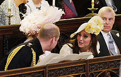 The Duke of Cambridge (left), the Duchess of Cambridge and the Duke of York during the wedding service for Prince Harry and Meghan Markle at St George's Chapel, Windsor Castle.