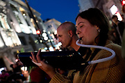 Climate protesters at Oxford Circus playing music. After the boat was removed, many of the protesters remained, staying locked on for another night. Several roads were blocked across four sites in central London, by the Extinction Rebellion climate change protests, April 2019.