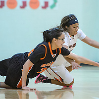 Gallup JV Bengal Ashley Antone (32) and Wingate Bear Ariel Brown (33) dive after the ball Saturday at Wingate High School.