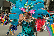 A feathered and costumed participant representing Gay Peruvians of the Americas, in the 2011 Pride Parade on New York's Fifth Avenue.