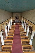 Pews and altar in interior of Church of Vilupulli on Chiloe Island, Chile