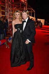 NICKY CLARKE and KELLY SIMPKIN at the Collars & Coats Gala Ball in aid of Battersea Dogs & Cats Home held at Battersea Evolution, Battersea Park, London on 7th November 2013.