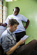 Dr Godfrey Kambanga and Dr Peter O'Reilly  examine patients notes from the children's ward, St Walburg's Hospital, Nyangao. Lindi Region, Tanzania.