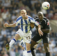 Fotball<br /> England 2005/2006<br /> Foto: SBI/Digitalsport<br /> NORWAY ONLY<br /> <br /> Huddersfield v Swansea<br /> Coca Cola League 1.<br /> 13/08/2005.<br /> Swansea's Kevin Austin battles with Huddersfield's Andy Booth