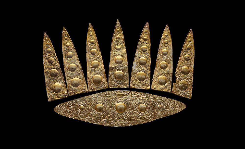 Top leaf shapes of a Mycenaean gold diadem from Grave III, 'Grave of a Women', Grave Circle A, Myenae, Greece. National Archaeological Museum Athens. Black Background<br /> Cat No 3,5. 16th century BC.<br /> <br /> Shaft Grave III, the so-called 'Grave of the Women,' contained three female and two infant interments. The women were literally covered in gold jewelry and wore massive gold diadems, while the infants were overlaid with gold foil. .<br /> <br /> If you prefer to buy from our ALAMY PHOTO LIBRARY  Collection visit : https://www.alamy.com/portfolio/paul-williams-funkystock/mycenaean-art-artefacts.html . Type -   Athens    - into the LOWER SEARCH WITHIN GALLERY box. Refine search by adding background colour, place, museum etc<br /> <br /> Visit our MYCENAEN ART PHOTO COLLECTIONS for more photos to download  as wall art prints https://funkystock.photoshelter.com/gallery-collection/Pictures-Images-of-Ancient-Mycenaean-Art-Artefacts-Archaeology-Sites/C0000xRC5WLQcbhQ