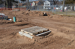 Hanover Elementary School - Kindergarten Addition.James R Anderson Photographer | photog.com 203-281-0717.Andrade Architects, LLC. Enfield Builders, Inc..Photography Date: 7 March 2012.Camera View: Northwest. New Utility Vault with old Foundation in line of utility trench..Image Number 05